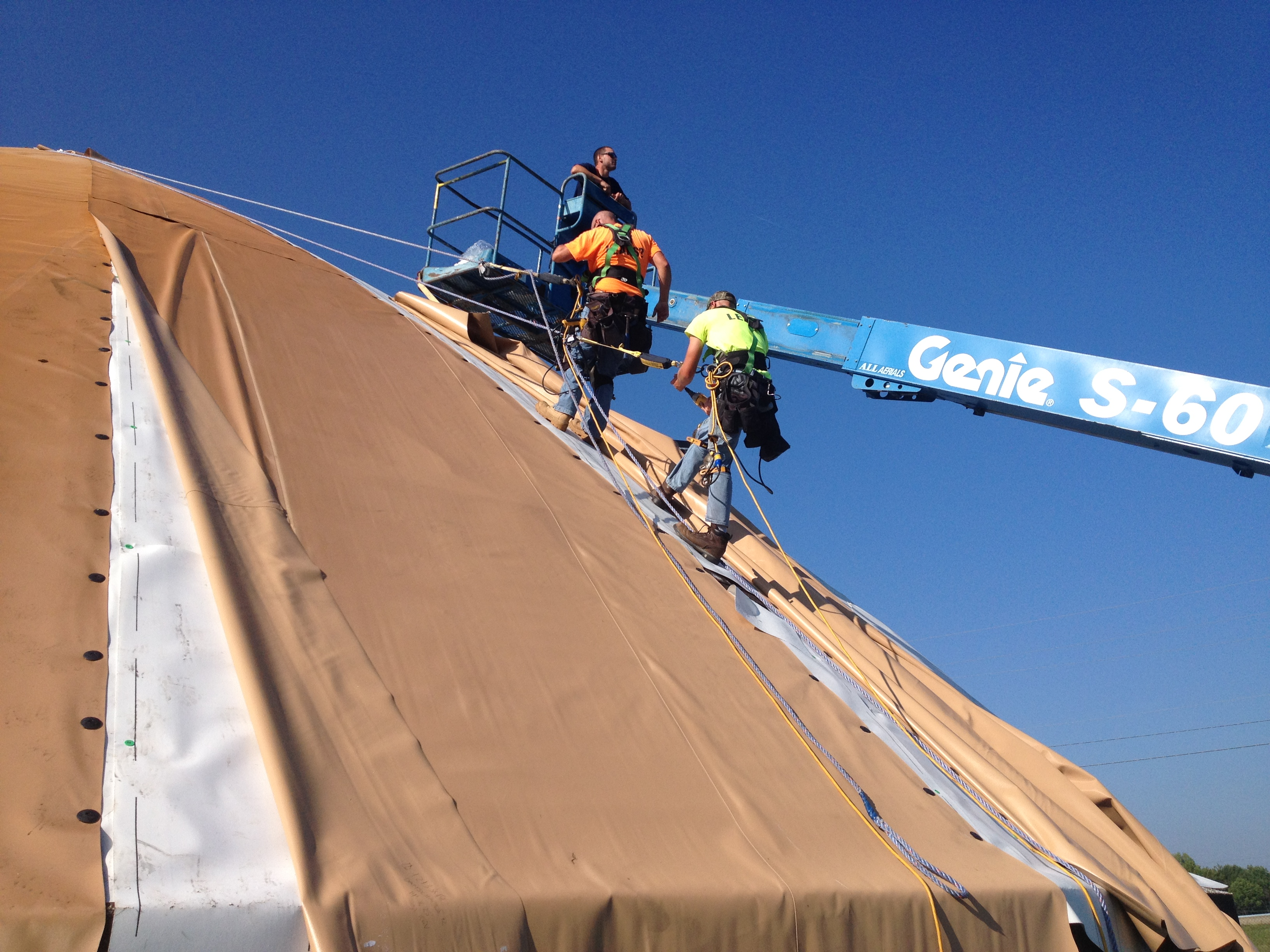 commercial roofing contractors working on a sloped roof